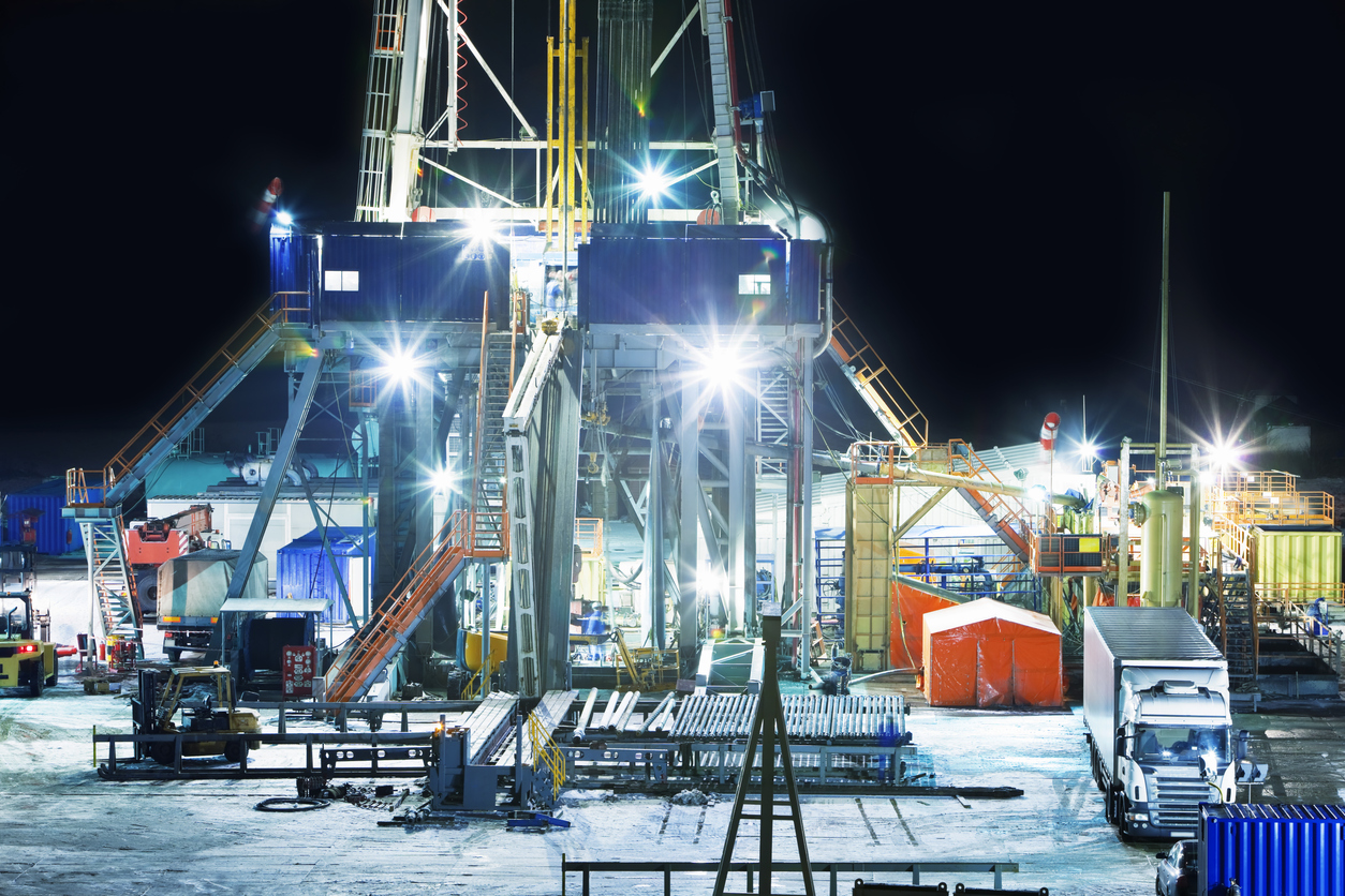 Land based oil drilling rig at night