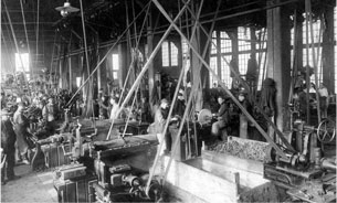 historical photo of belt driven machinery